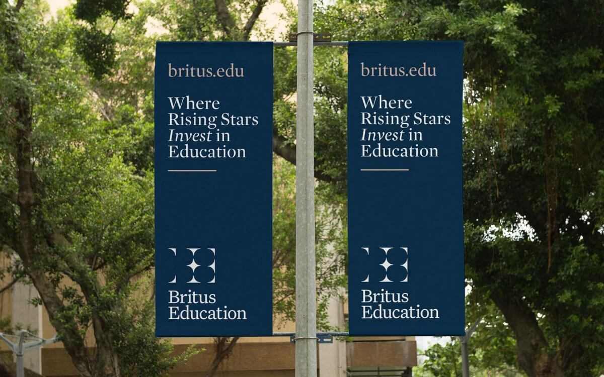 Britus education brand flags in garden sporting their IVIA award winning identity